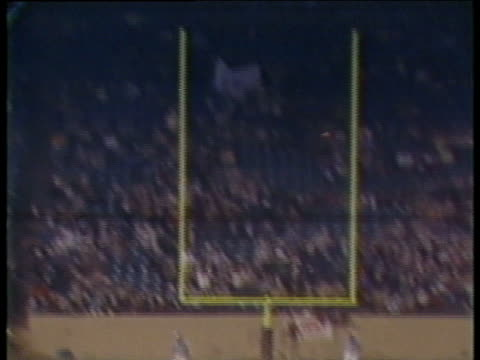 1984 montage ha ws tu pittsburgh maulers kicker tony lee scoring field goal from 28 yards out to tie game against michigan panthers / ms referee standing with arms up / ms tony lee shaking hands with teammates after kick / pontiac, michigan, usa - football goal post stock videos and b-roll footage