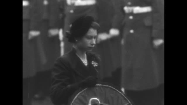 montage queen elizabeth ii stands in front of the cenotaph at the remembrance sunday ceremony in london; philip, duke of edinburgh, stands behind /... - remembrance sunday stock videos & royalty-free footage