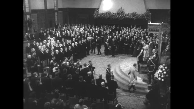 montage queen juliana and prince bernhard take seats at thrones in the ridderzaal for the queen's speech of state opening the dutch parliament /... - the queen's speech state opening of uk parliament stock videos & royalty-free footage