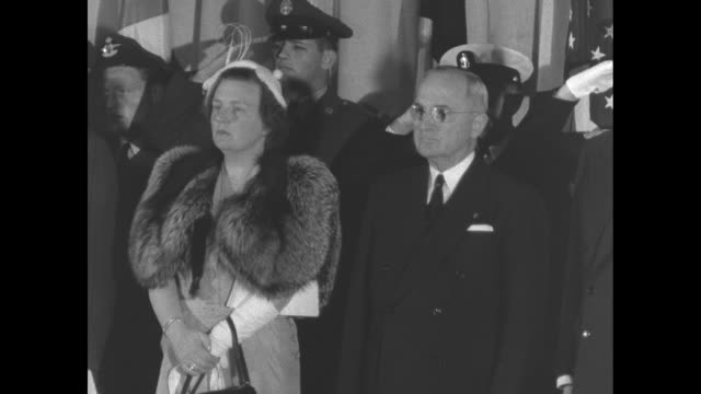 Montage Queen Juliana of the Netherlands US President Harry Truman US Secretary of State Dean Acheson and others stand as National Anthems of the...