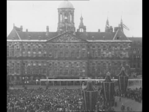 montage queen wilhelmina princess juliana prince bernhard enter balcony of royal palace in amsterdam / ws royal palace with crowds in front / queen... - abdication stock videos and b-roll footage