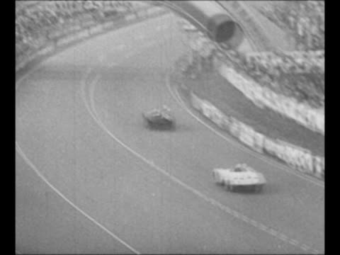 vídeos de stock e filmes b-roll de montage race cars speed on track in french grand prix race / three cars slow have trouble at first turn but no one hurt / montage cars race on track... - 1955