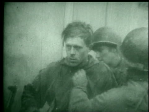 a montage reveals soldiers gathering together nazi prisoners of war, a tank in the snow, and a nazi symbol. - prisoner of war stock videos & royalty-free footage