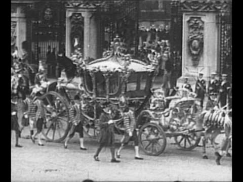 montage royal coach leaves buckingham palace bearing george vi and queen elizabeth to westminster abbey for coronation ceremony and rides through... - coronation stock videos & royalty-free footage