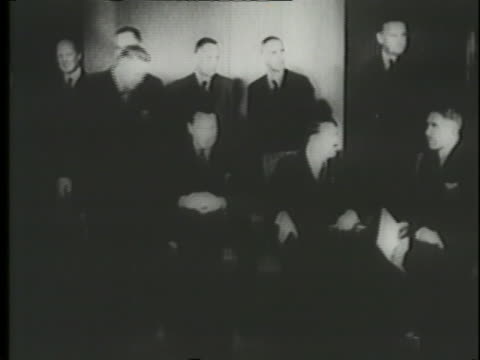 a montage shows a newspaper clip and a meeting of officials with adolf hitler. - chancellor of germany stock videos & royalty-free footage