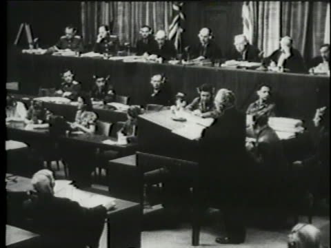 a montage shows a testimony during the nuremberg trials. - nuremberg trials stock videos & royalty-free footage