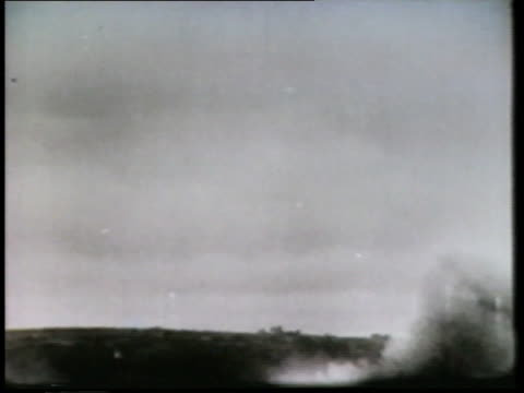 a montage shows bombs dropping, ships fighting at sea, paratroopers, and tanks. - amphibious vehicle stock videos & royalty-free footage