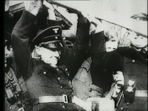 vidéos et rushes de a montage shows cavalries, soldiers marching, and tanks. - soldat