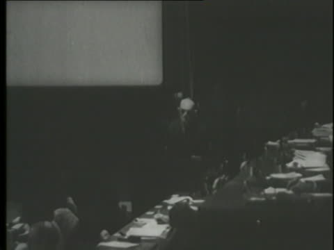 a montage shows defendants at the famous nuremberg trials as well as buildings and carriages in poland. - nuremberg trials stock videos & royalty-free footage