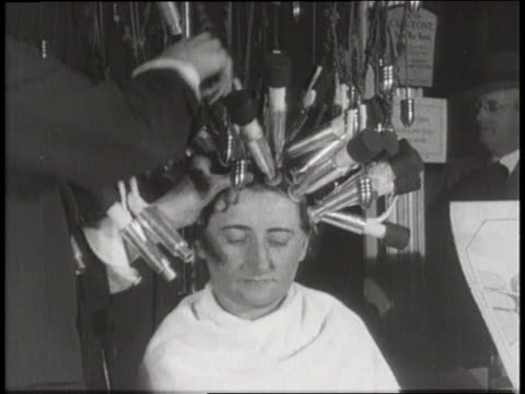 A montage shows hairdressers using many techniques to give women wavy or curly hairstyles