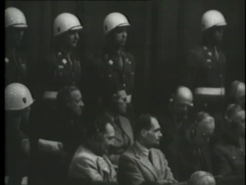 a montage shows speakers at the nuremberg trials. - nuremberg trials stock videos & royalty-free footage