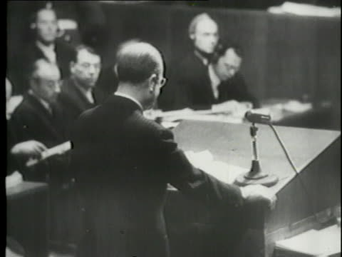 a montage shows testimonies at the nuremberg trials and documents from adolf hitler. - nuremberg trials stock videos & royalty-free footage