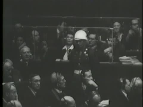 a montage shows testimonies at the nuremberg trials. - nuremberg trials stock videos & royalty-free footage