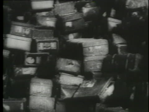 a montage shows  victims of the holocaust. - genocide stock videos & royalty-free footage