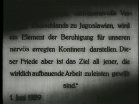 stockvideo's en b-roll-footage met a montage shows videos of documents, air raids and soldiers. - joegoslavië