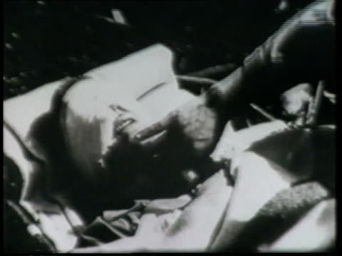 a montage shows wounded soldiers, an explosion, and devastation from a bomb raid in world war ii. - injured stock videos & royalty-free footage