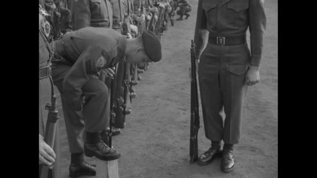 montage soldiers of the 27th canadian infantry brigade group buff shoes in line as they prepare for military review by philip duke of edinburgh in... - regiment stock videos and b-roll footage