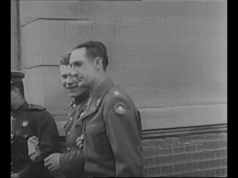 montage soviet and us officers exit building and walk arm in arm down steps after their forces meet at the elbe river in torgau germany during world... - arm in arm stock videos & royalty-free footage