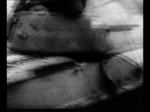 vidéos et rushes de montage soviet tanks move on polish road during world war ii drive toward berlin / montage soviet military planes fly / ws german military plane... - armée rouge