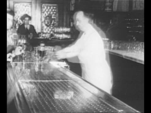 vídeos de stock e filmes b-roll de montage spedup shots bartenders serve customers at bar customers drink beer / black / end credits / from greatest headlines of the century series - time lapse de movimento rápido