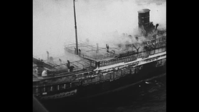 montage ss morro castle burns a few miles off the coast of new jersey / lifeboats approach nj shore through rough water / court proceeding in new... - captain stock videos and b-roll footage