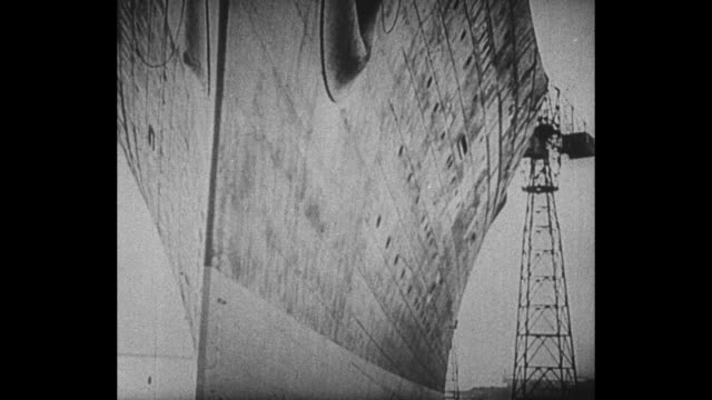 montage ss normandie in slip in saint-nazaire, france, in 1930s / montage rms queen mary in slip at clydebank, scotland, just prior to her launch - scotland stock videos & royalty-free footage