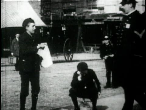 montage - steet scenes. - boy selling newspapers on the street. - top hat stock videos & royalty-free footage