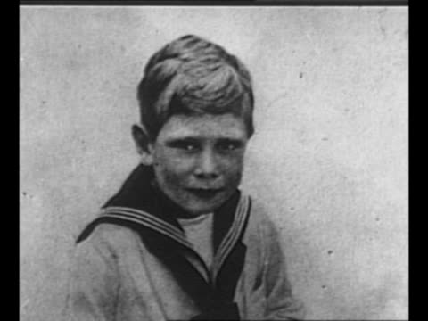 montage stills of george vi, as prince albert, in youth: at age two, in first sailor suit, in scottish uniform, as naval cadet / george v and queen... - britisches königshaus stock-videos und b-roll-filmmaterial