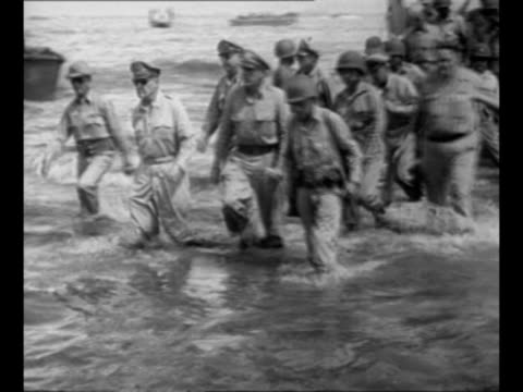 Montage Supreme Commander Douglas MacArthur and entourage wade onto Leyte island in the Philippines during World War II Philippine president Sergio...