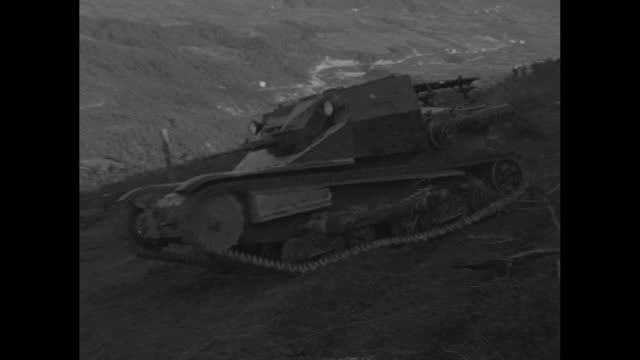 montage tanks approach down slope, running over small trees in their path, as the italian military conducts maneuvers in the italian alps / tanks... - tank stock videos & royalty-free footage