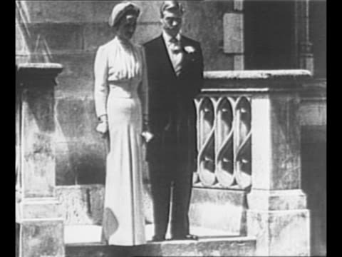 stockvideo's en b-roll-footage met montage the duke of windsor formerly edward viii and the duchess of windsor exit chateau de cande in france after their wedding and pose for photos /... - koning koninklijk persoon