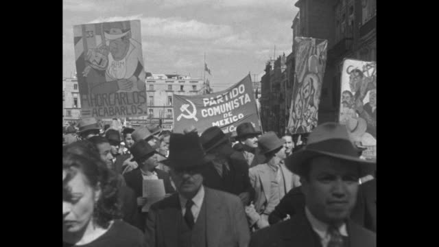 montage thousands of mexican workers march in streets of mexico city some bearing banners as workers show their support of president lazaro cardenas... - 1936 stock-videos und b-roll-filmmaterial