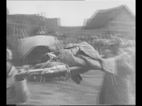 montage three chinese national revolutionary army soldiers load, fire american-made gun during battle for suchow / chinese officer looks through... - mao tse tung video stock e b–roll