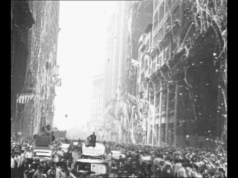 montage ticker tape parade for douglas wrong way corrigan in new york city ny he rides in car in parade with nyc mayor fiorello laguardia who is... - fiorello la guardia stock videos & royalty-free footage