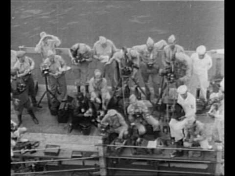 montage tiltdown shot supreme commander for the allied powers gen douglas macarthur walks on deck of uss missouri / tiltdown shot journalists and... - japanese surrender stock videos and b-roll footage