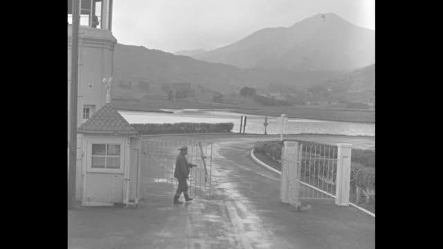 Montage travel shot through exit gate of San Quentin State Prison in California as guard opens gate / montage creamery where convicts hid after...