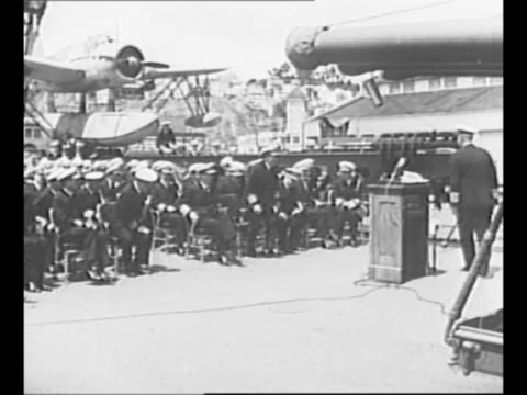montage us admiral chester nimitz receives the distinguished service medal from fleet admiral ernest king in part for his actions during the battle... - ピンを刺す点の映像素材/bロール