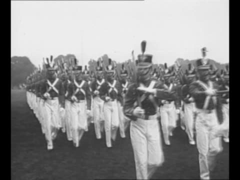 Montage US Army cadets march in formation on grounds of West Point Military Academy in 1948 / montage US Navy midshipmen march on grounds of United...