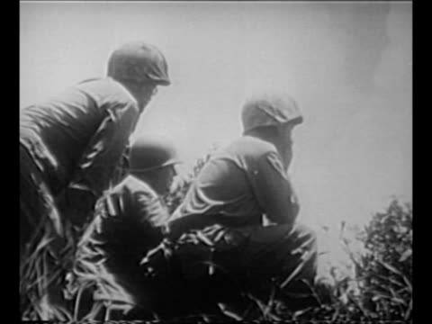 Montage US General Simon Buckner Jr points crouches with soldiers at observation post watches action during battle for Okinawa during World War II /...