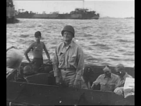 vídeos de stock, filmes e b-roll de montage us navy fleet admiral chester w nimitz with troops on kwajalein island / nimitz salutes from landing barge / six planes fly in formation... - navio de desembarque de doca