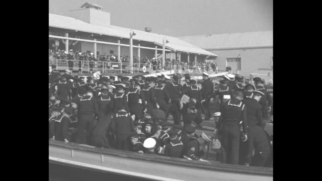 montage us navy sailors disembark from launches as they arrive in long beach ca after a tour of duty they carry suitcases boxes bags duffel bags /... - 1934 stock videos & royalty-free footage