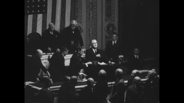 montage us president franklin d roosevelt addresses joint session of us congress he grips podium with one hand as he speaks nbc and cbs microphones... - d day stock videos & royalty-free footage