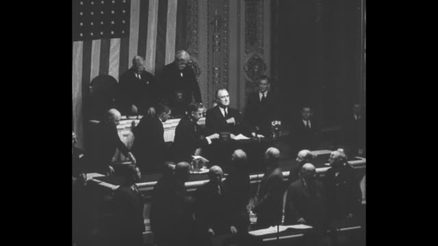 Montage US President Franklin D Roosevelt addresses joint session of US Congress he grips podium with one hand as he speaks NBC and CBS microphones...
