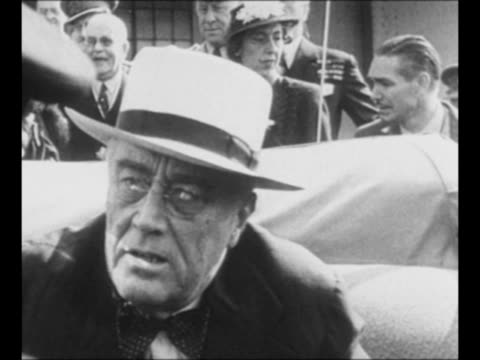 montage us president franklin roosevelt seated in car leans out to talk to uk prime minister winston churchill / churchill roosevelt and canadian... - herbst stock videos & royalty-free footage
