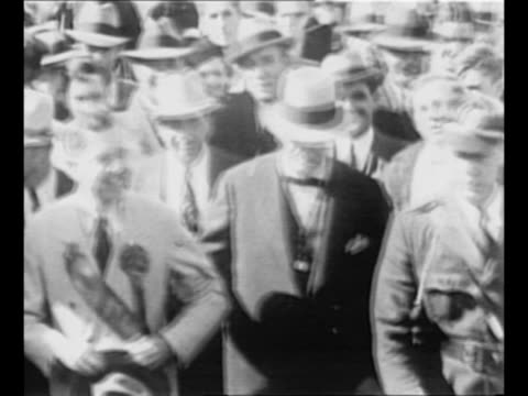 montage us senator huey long walks in a parade held before a football game between louisiana state university and vanderbilt university he walks with... - 1934 stock videos & royalty-free footage