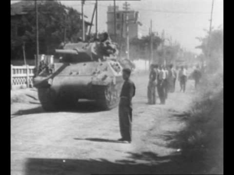 montage us tank turns corner, drives on rome street as 5th united states army arrives in rome during world war ii / tank approaches as it drives on... - tank stock videos & royalty-free footage