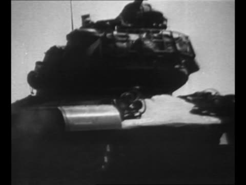 montage us tanks arrive at outskirts of detonation area atomic bomb will be detonated here to examine its effects on buildings and people / troops... - radioaktiver niederschlag stock-videos und b-roll-filmmaterial