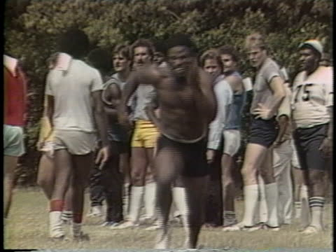 1983 Montage WS USFL football player running drills during team practice / CU Hand holding stopwatch / USA