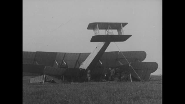 vidéos et rushes de montage vickers-vimy bomber nose-down in bog in clifden, ireland, after aviators john alcock and arthur whitten brown land there while completing the... - biplan