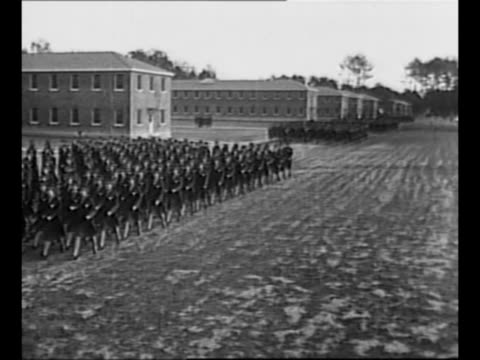 Montage WAACs stand at attention on parade grounds at Fort Des Moines IA as WAAC director Oveta Culp Hobby conducts troop review in 1942 / montage US...